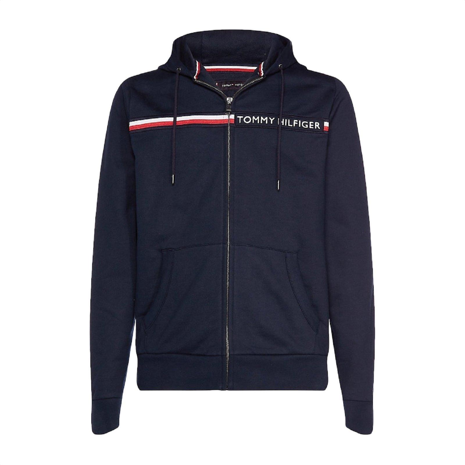 8660cd0f57a0d Sweat zippé à capuche et bande emblématique. Sweat zippé à capuche de  couleur marine pour homme de la marque Thommy Hilfiger :